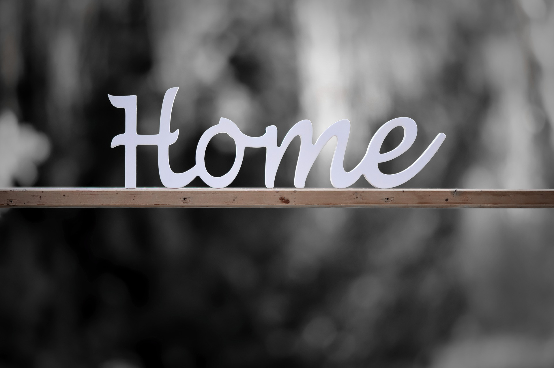 Sign that says Home
